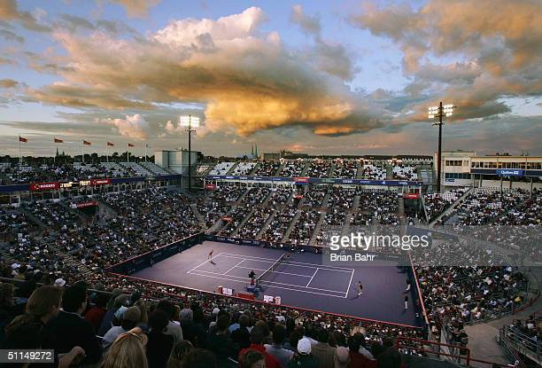 The sun sets as Anastasia Myskina of Russia plays Magdalena Maleeva of Bulgaria during the quarterfinals of the Rogers Cup tennis on August 6 2004 at...