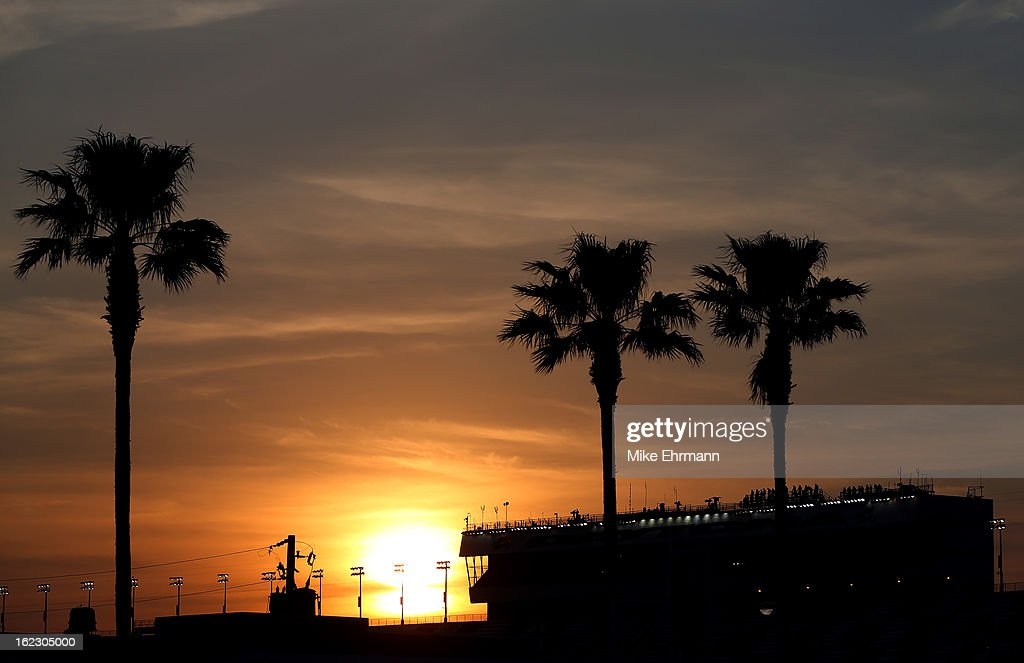 The sun sets as drivers practice for the NASCAR Camping World Series Next Era Energy Resources 250 at Daytona International Speedway on February 21...