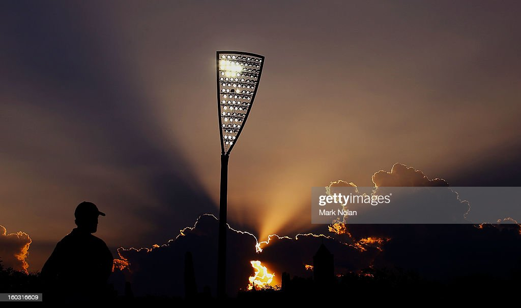 The sun sets as Manuka Oval hosts cricket under lights for the first time during the International Tour Match between the Prime Minister's XI and West Indies at Manuka Oval on January 29, 2013 in Canberra, Australia.