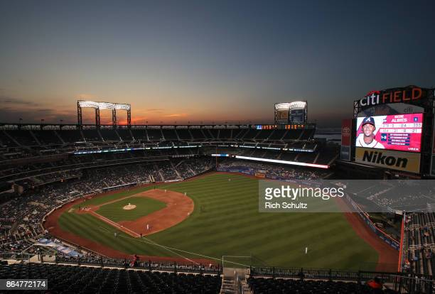 The sun sets as the Atlanta Braves play the New York Mets during the first game of a double header at Citi Field on September 25 2017 in the Flushing...
