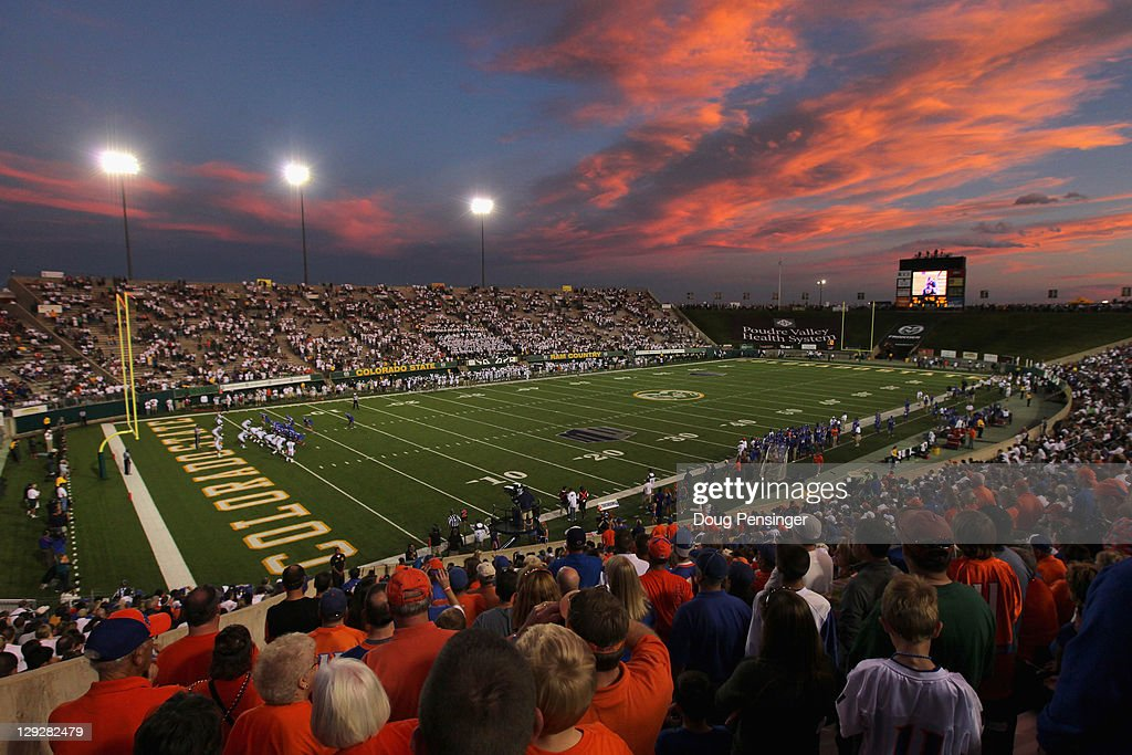 The sun sets as the Boise State Broncos face the Colorado State Rams at Sonny Lubick Field at Hughes Stadium on October 15 2011 in Fort Collins...