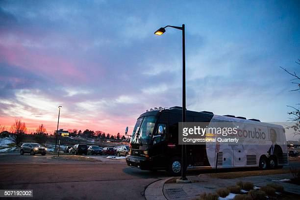 STATES JANUARY 27 The sun sets as the campaign bus for Republican presidential candidate Marco Rubio is seen at a campaign stop in West Des Moines...