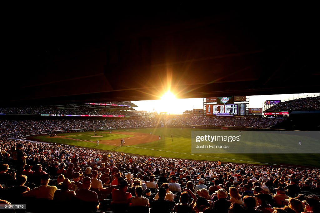 The sun sets as the Colorado Rockies take on the Philadelphia Phillies at Coors Field on July 7, 2016 in Denver, Colorado.