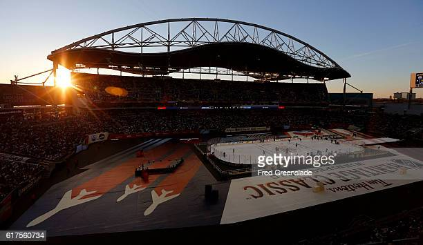 The sun sets as the Winnipeg Jets and Edmonton Oilers play the 2016 Tim Hortons NHL Heritage Classic hockey game on October 23 2016 at Investors...