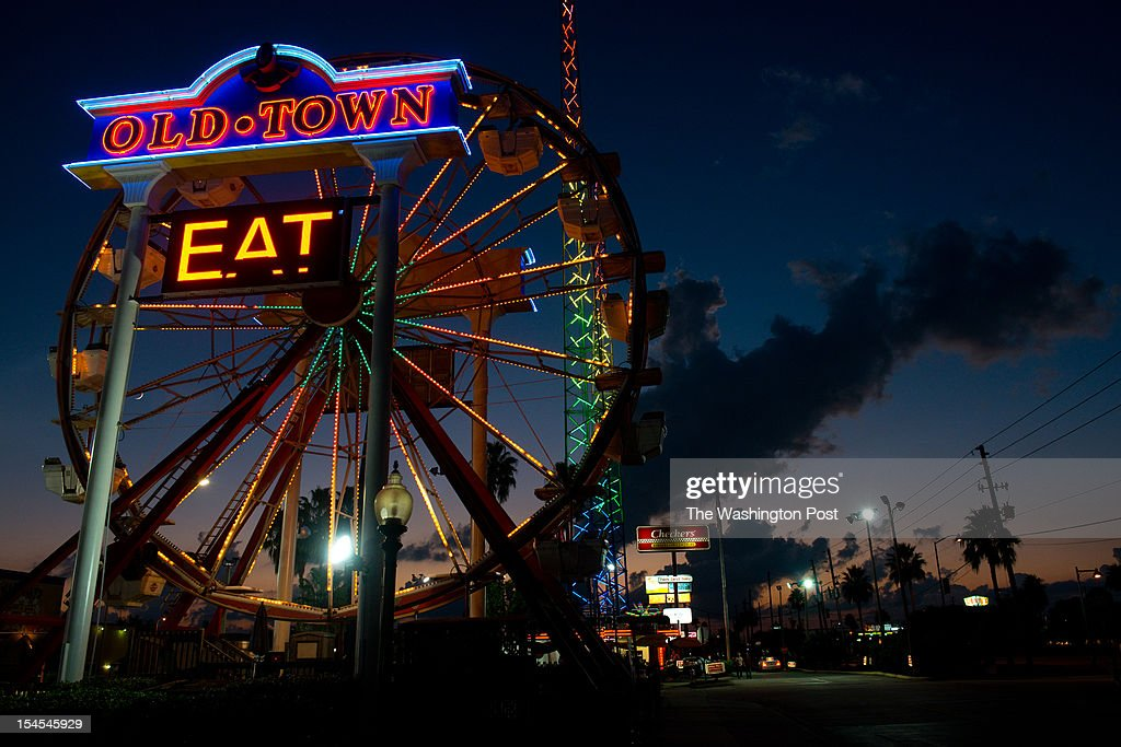 The sun sets behind a ferris wheel at Old Town in Kissimmee Florida The Latino vote could be decisive in swing states such as Florida The majority of...