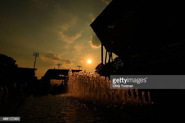 The sun sets behind Arthur Ashe Stadium during day one of the 2015 US Open at the USTA Billie Jean King National Tennis Center on August 31 2015 in...