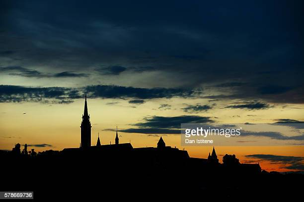 The sun sets behind Matthias Church on Buda Castle Hill next to the River Danube during previews ahead of the Formula One Grand Prix of Hungary at...
