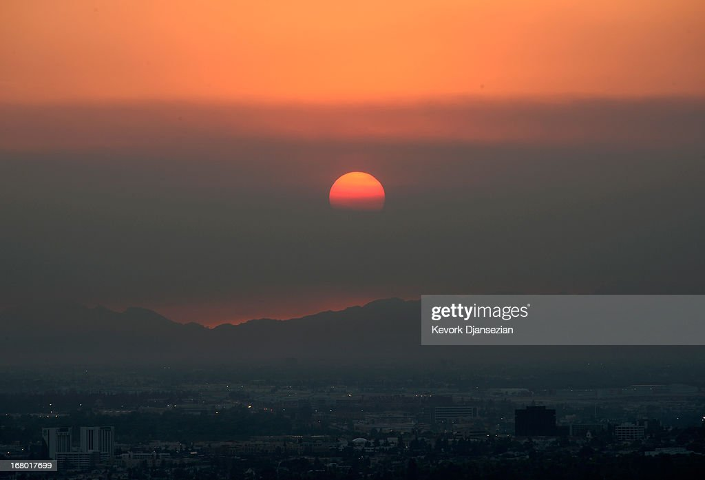 The sun sets behind smoke clouds from the Springs fire in Newbury Park and Camarillo on May 3, 2013 in Glendale, California. The fire has already spread to more than 28,000 acres and is only 20-30 percent contained. It's damaged dozens of structures and put some 4,000 people in harm's way.