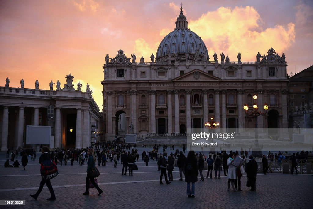 The sun sets behind St Peter's Basilica in St Peter's Square on March 11, 2013 in Vatican City, Vatican. Cardinals are set to enter the conclave to elect a successor to Pope Benedict XVI after he became the first pope in 600 years to resign from the role. The conclave is scheduled to start on March 12 inside the Sistine Chapel and will be attended by 115 cardinals as they vote to select the 266th Pope of the Catholic Church.