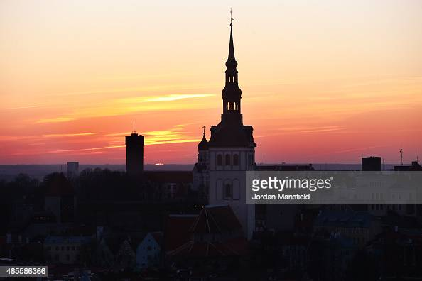 The sun sets behind Tallinn Town Hall on March 8 2015 in Tallinn Estonia
