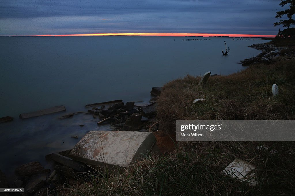 The sun sets behind the Anchor of Hope Cemetery that is slowly eroding into the Chesapeake Bay October 29 2014 in Hoopers Island Maryland Willey...
