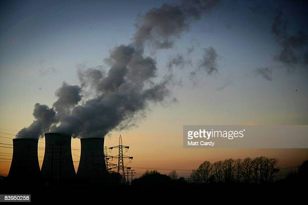 The sun sets behind the chimneys at Didcot Power Station a dual coal and gas fired power station supplying power to the national grid on December 7...