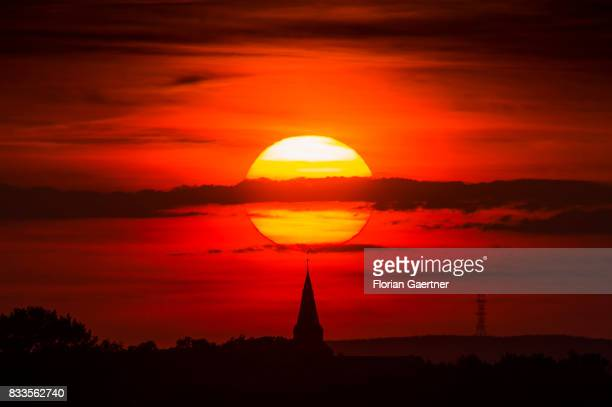 The sun sets behind the church Marienkirche on August 14 2017 in Salzwedel Germany