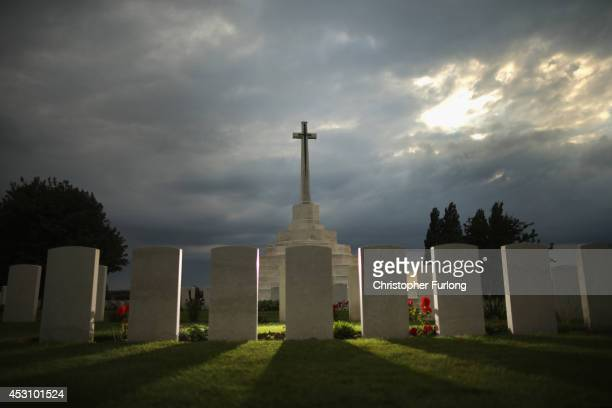 The sun sets behind the Cross of Sacrifice at Tyne Cot Commonwealth War Graves Commission Memorial on August 2 2014 in Passchendaele Belgium Monday...