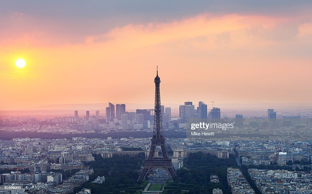 The sun sets behind the Eiffel Tower on June 10 2008 in Paris France