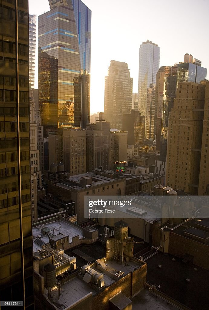 The sun sets behind the highrise buildings near Times Square and Broadway as seen in this 2009 New York, NY, early evening cityscape photo.