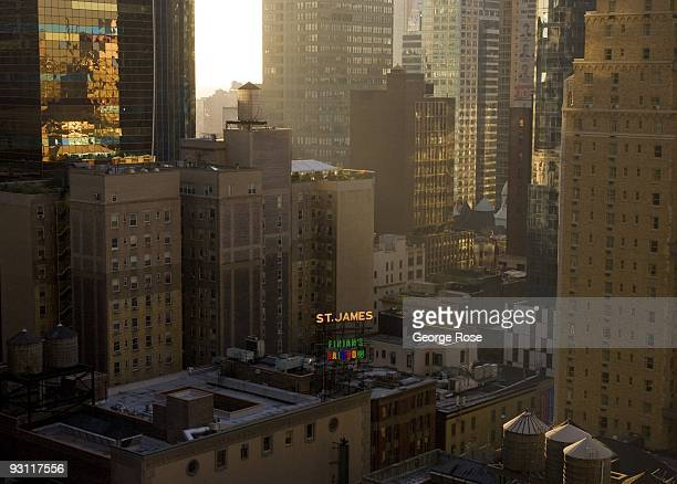 The sun sets behind the highrise buildings near Times Square and Broadway as seen in this 2009 New York NY early evening cityscape photo