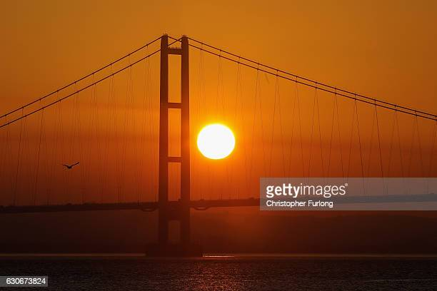 The sun sets behind the Humber Bridge as the City of Hull gets ready to be the offical 2017 UK City of Culture on December 29 2016 in Hull England...