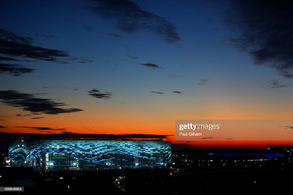 The sun sets behind the Iceberg Skating Palace during previews ahead of the Russian Formula One Grand Prix at Sochi Autodrom on October 8 2014 in...