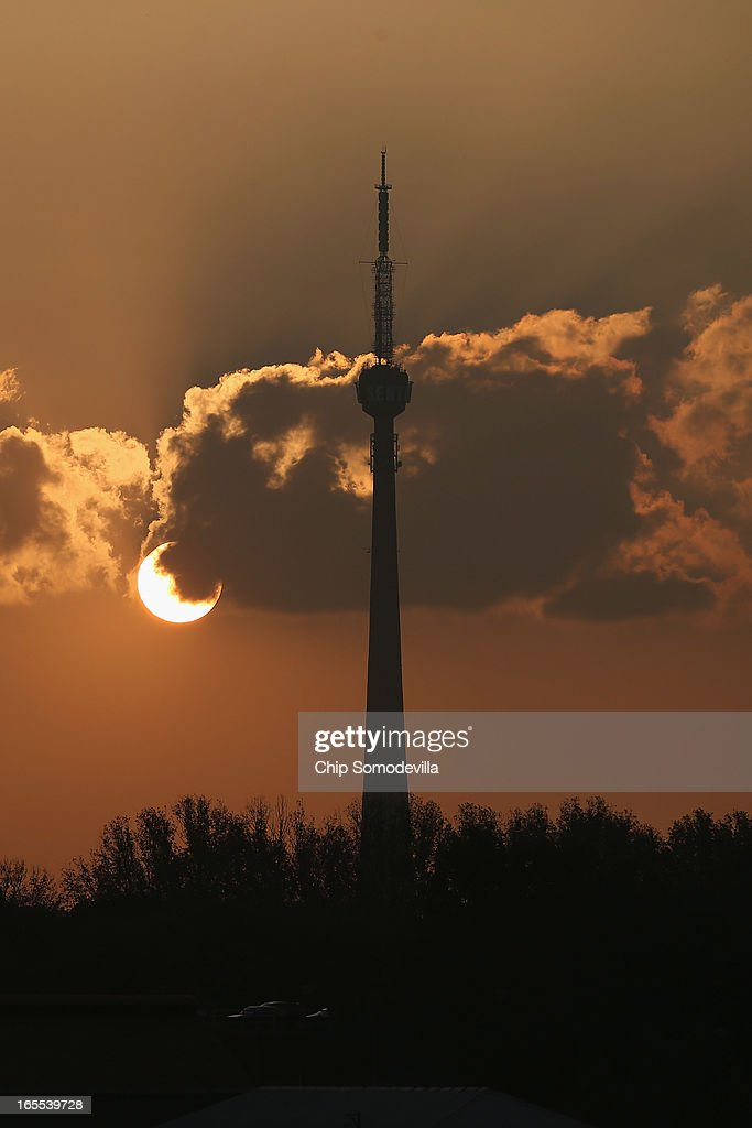 The sun sets behind the landmark Sentech Tower April 4, 2013 in Johannesburg, South Africa. According to government officials, Noble Peace Prize laureate and former South African President Nelson Mandela, 94, contiunes to recover from pneumonia after spending more than a week in the hospital, his third time since December.