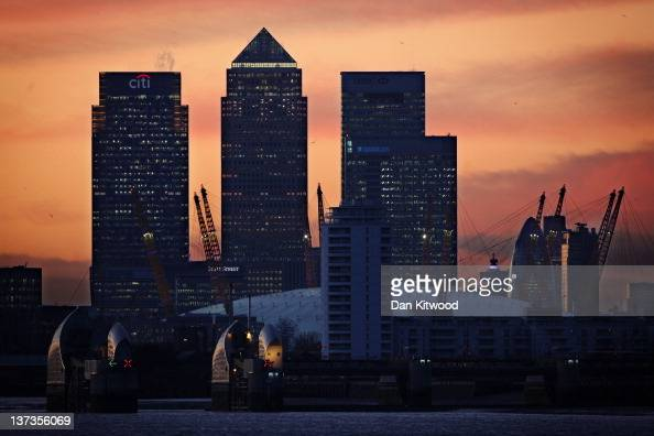 The sun sets behind The London Skyline featuring Canary Wharf the Gherkin the O2 Thames barrier and BT tower after a security exercise along the...