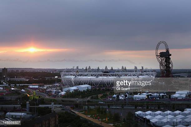 The sun sets behind the Olympic Stadium prior to the Opening Ceremony of the Olympic Games on July 27 2012 in London England Athletes heads of state...