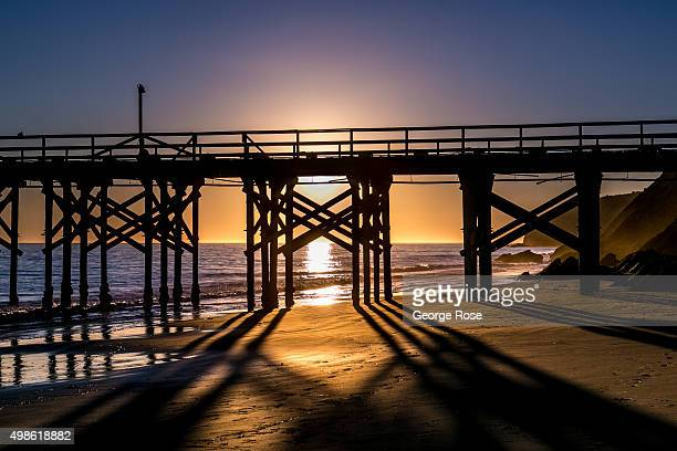 The sun sets behind the pier at Gaviota State Beach on November 15 in Gaviota California Because of its close proximity to Southern California and...