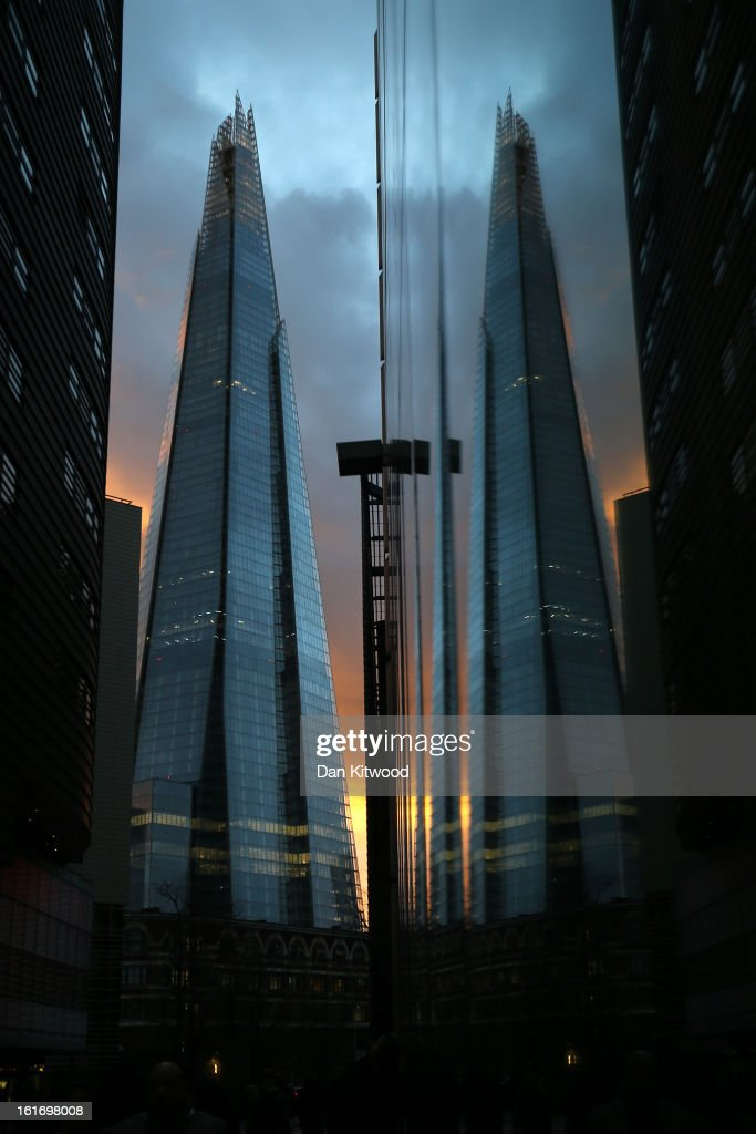The sun sets behind the Shard on February 14, 2013 in London, England. The Shard, at 310m is the tallest building in Western Europe and has recently opened a public viewing deck on the 68th, 69th and 72nd floors.