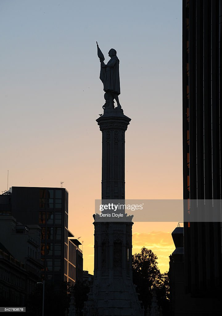 The sun sets behind the statue of Christopher Columbus at Colon square where the right-wing Popular Party are holding their closing rally ahead of Spanish General Elections on June 24, 2016 in Madrid, Spain. Spanish voters head back to the polls on June 26 after the last election in December failed to produce a government. Latest opinion polls suggest the Unidos Podemos left-wing alliance could make enough gains to come in second behind the caretaker government of the center-right Popular Party.