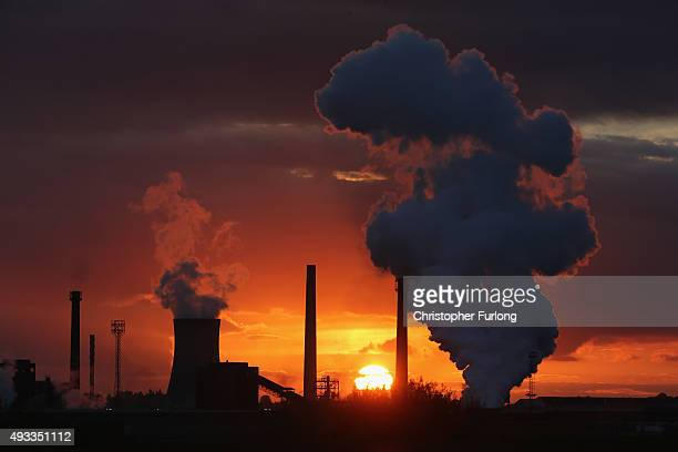 The sun sets behind the Tata Steel processing plant at Scunthorpe which may make 1200 workers redundant on October 19 2015 in Scunthorpe England Up...
