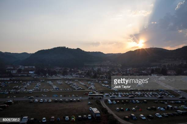 The sun sets behind the town of Guca during the Guca Trumpet Festival on August 11 2017 in Guca Serbia Thousands of revellers attend the trumpet...