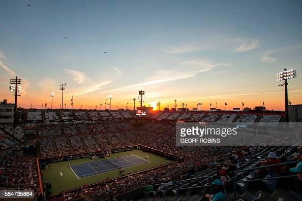 TOPSHOT The sun sets behind Uniprix Stadium in Montreal Quebec July 30 2016 as Elena Vesnina and Ekaterina Makarova of Russia take on Christina...