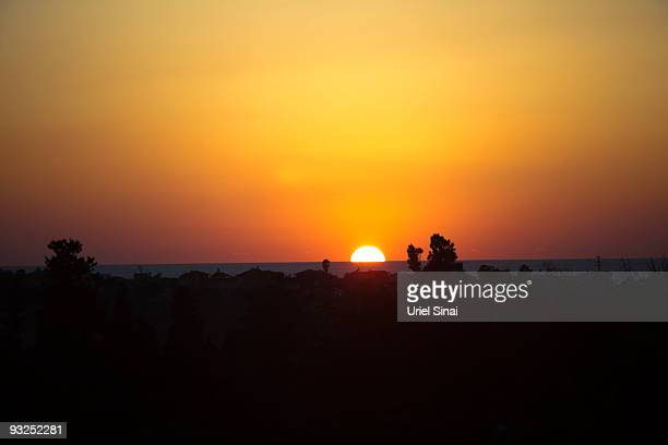 The sun sets beyond the sea November 15 2009 near the village of Kfar Vitkin in central Israel With the government encouraging the development of...