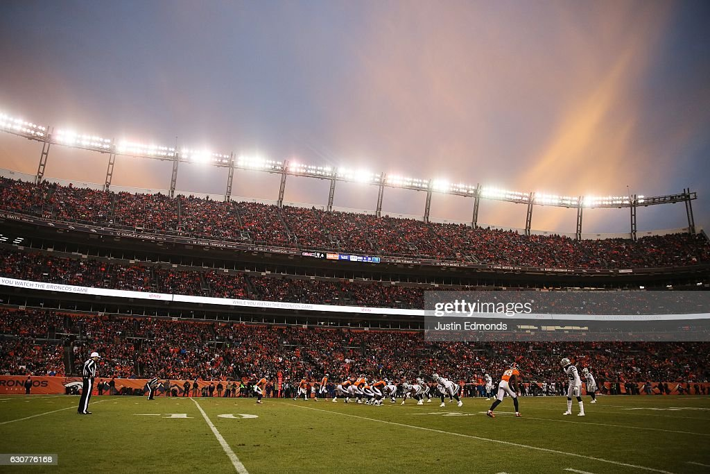 The sun sets during the fourth quarter of the game between the Denver Broncos and the Oakland Raiders at Sports Authority Field at Mile High on January 1, 2017 in Denver, Colorado.