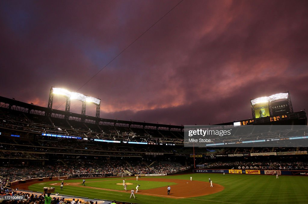 The sun sets during the game between the Arizona Diamondbacks and the New York Mets at Citi Field on July 1, 2013 at Citi Field in the Flushing neighborhood of the Queens borough of New York City.