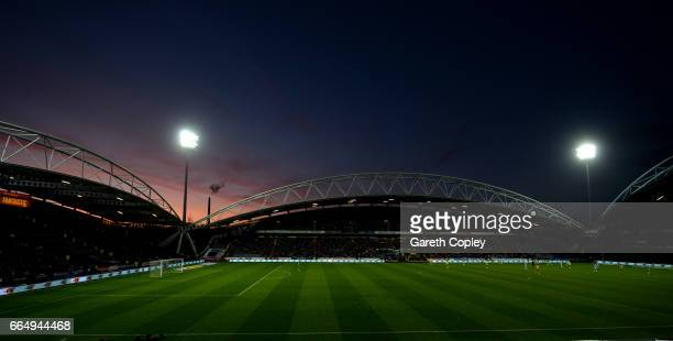 The sun sets during the Sky Bet Championship match between Huddersfield Town and Norwich City at Galpharm Stadium on April 5 2017 in Huddersfield...