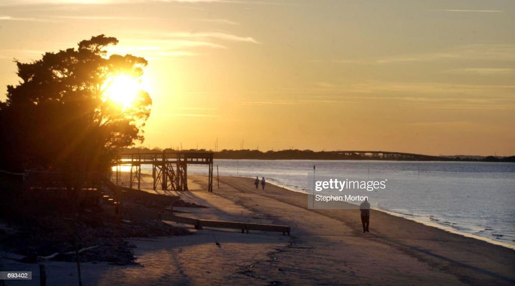 The sun sets near the beach front home of Sandra Bullock January 11 2002 on Tybee Island Georgia Bullock bought the home after filming 'Forces of...