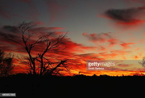 The sun sets near Uluru also known as Ayers Rock at sunset on April 21 2014 in Ayers Rock Australia The Duke and Duchess of Cambridge are on a...