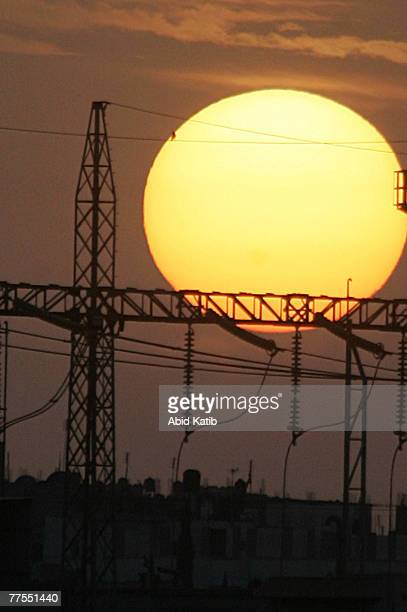 The sun sets next to the main Palestinian electricity company in AlNusairat on October 29 2007 in Khan Younis Gaza Strip Israel began reducing the...