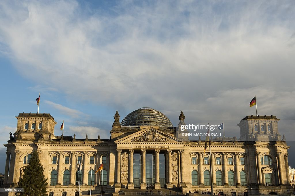 The sun sets on Berlin's Reichstag building which houses Germany's lower house of parliament, December 30, 2012.