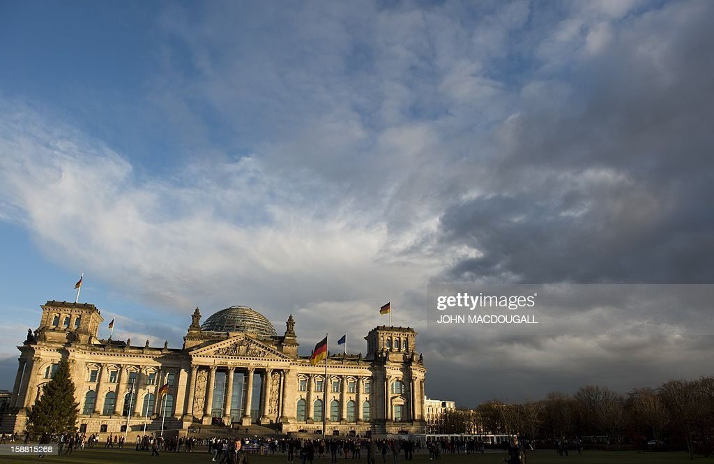 The sun sets on Berlin's Reichstag building which houses Germany's lower house of parliament, on December 30, 2012.