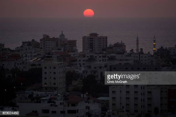 The sun sets on July 19 2017 in Gaza City Gaza For the past ten years Gaza residents have lived with constant power shortages in recent years these...