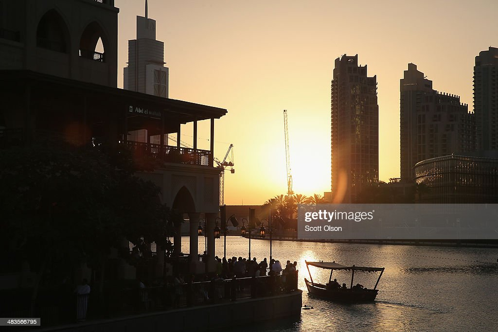 The sun sets on the Burj Khalifa Lake on April 9, 2014 in Dubai, United Arab Emirates. At 2,722 ft, the Burj Khalifa building is the world's tallest man-made structure.