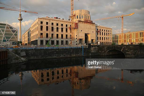 The sun sets on the construction site of the Berliner Schloss city palace on May 19 2015 in Berlin Germany The ambitious project located in the city...