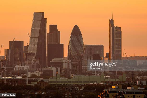 The sun sets on the horizon beyond skyscrapers including The Leadenhall Building also known as the 'Cheesegrater' left Tower 42 second left 30 St...