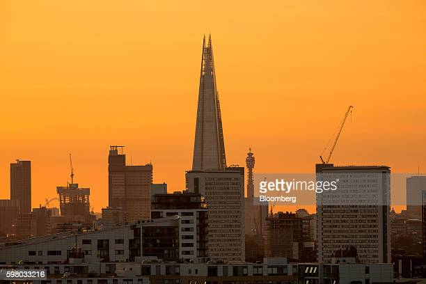 The sun sets on the horizon beyond The Shard skyscraper center in the City of London UK on Tuesday Aug 30 2016 Few places in greater London...