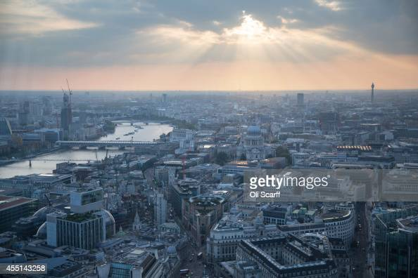 The sun sets on the London skyline viewed from an upper floor of a newly constructed skyscraper The Leadenhall Building on September 9 2014 in London...