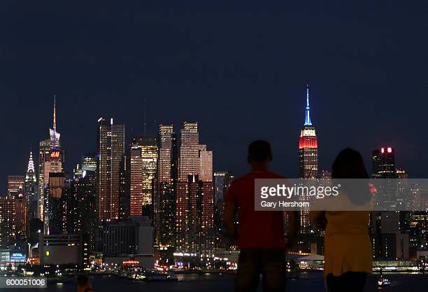 The sun sets on the skyline of midtown Manhattan and the Empire State Building in New York City on September 5 2016 as seen from Weehawken NJ