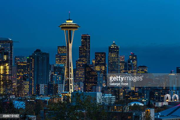 The sun sets on the Space Needle and downtown skyline as viewed at dusk on November 4 in Seattle Washington Seattle located in King County is the...