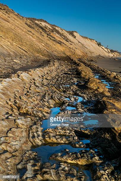 The sun sets on the unusual rock formations found at Gaviota State Beach on November 15 in Gaviota California Because of its close proximity to...